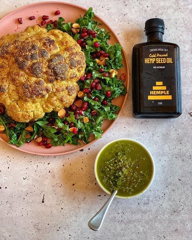 Maple Mustard Whole Roast Cauliflower w/ Pomegranate Salad & Hemp Herb Sauce